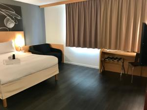 A bed or beds in a room at easyHotel Nice Palais des Congrès – Old Town