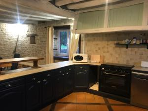 A kitchen or kitchenette at Le Boursignoux