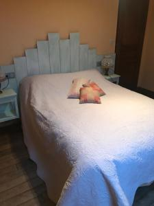 A bed or beds in a room at Le Boursignoux
