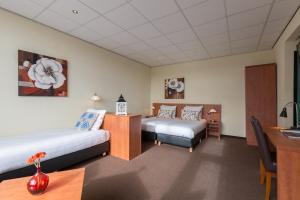 Un ou plusieurs lits dans un hébergement de l'établissement Aquarius Hotel