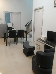 A seating area at RUMAH ALIFA BLOK A1
