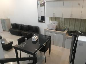 A kitchen or kitchenette at RUMAH ALIFA BLOK A1