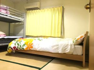 A bed or beds in a room at IM guest house