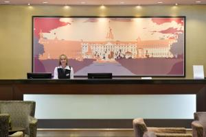 A television and/or entertainment center at ACHAT Hotel Karlsruhe City