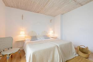 A bed or beds in a room at Can Beia Hostal Boutique