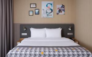 Кровать или кровати в номере Holiday Inn Perm