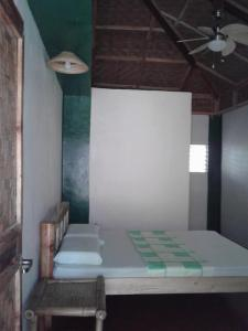 A bed or beds in a room at Chelle's Guesthouse and Backpackers