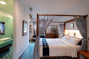 A bed or beds in a room at Residence Bassac