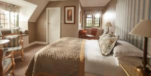 A bed or beds in a room at Mallory Court Country House Hotel & Spa