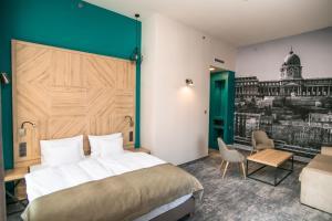 Un ou plusieurs lits dans un hébergement de l'établissement T62 Hotel