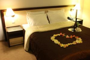 A bed or beds in a room at Business Hotel Premier
