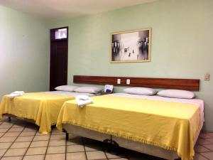 A bed or beds in a room at Hotel Pousada Dos Ventos