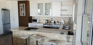 A kitchen or kitchenette at Lagoon Beach Hotel & Spa