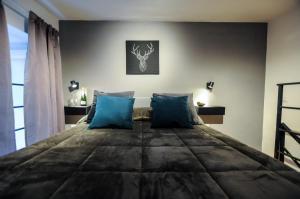 Letto o letti in una camera di Santa Lucia Essential Home