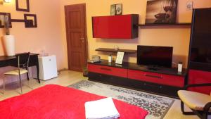 A television and/or entertainment center at Atia Residence