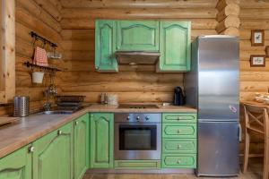 A kitchen or kitchenette at Mountain family home Nola Ivano
