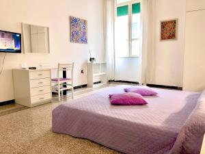 A bed or beds in a room at Casa Vacanze Sunshine