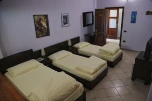 A bed or beds in a room at Resort Nord Park