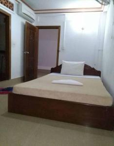 Ein Bett oder Betten in einem Zimmer der Unterkunft Angkor Ruby Guesthouse