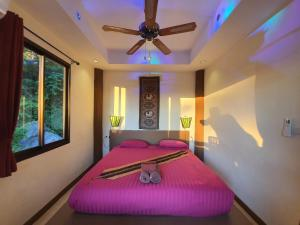 A bed or beds in a room at Moonstone Studio