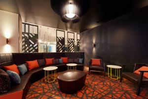 A seating area at Holiday Inn Express Adelaide City Centre, an IHG Hotel