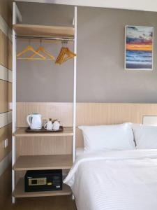 A bed or beds in a room at Walk In Hotel