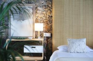 A bed or beds in a room at Hacienda El Socorro