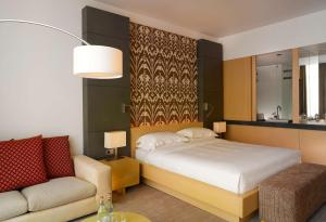 A bed or beds in a room at Hyatt Regency Dushanbe