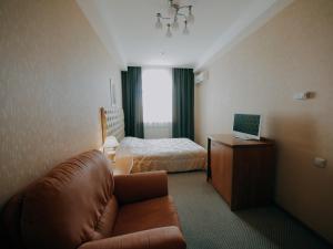 Кровать или кровати в номере Гостиница ДеЖаВю