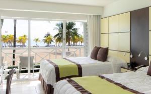 Кровать или кровати в номере Viva Wyndham Fortuna Beach All Inclusive