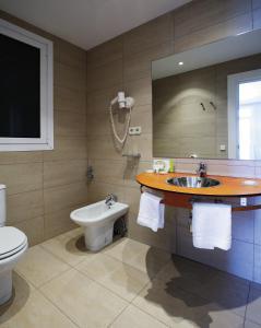Een badkamer bij Hotel Niza