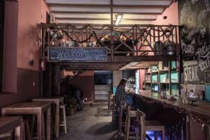 A restaurant or other place to eat at The Adventure Brew Hostel