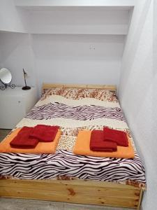 Кровать или кровати в номере Appartment on Belorysskaya
