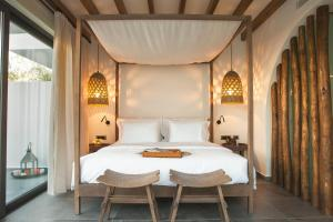 A bed or beds in a room at Lindian Village & Suites