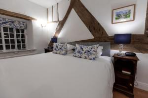 A bed or beds in a room at West Arms Hotel