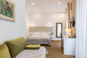 A bed or beds in a room at Pellegrini Luxury Rooms