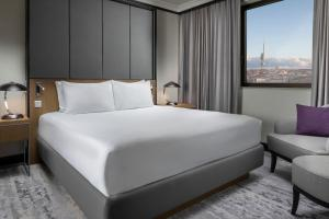A bed or beds in a room at Hilton Prague Hotel