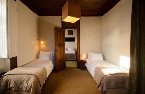 Uma cama ou camas num quarto em Casa com Historia