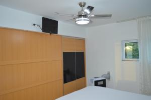 A television and/or entertainment center at Residences Sommet Port Salut