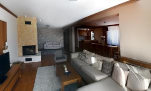 Aparthotel Vucko tesisinde bir oturma alanı