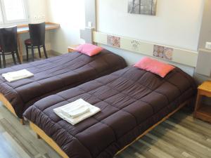 Un ou plusieurs lits dans un hébergement de l'établissement Hôtel et Restaurant de La Vallée