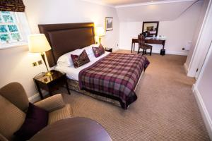 A bed or beds in a room at Macdonald Pittodrie House