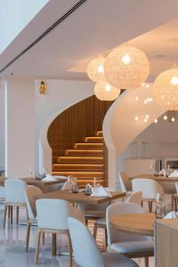 A restaurant or other place to eat at Aroeira Lisbon Hotel - Sea & Golf