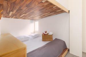 Un ou plusieurs lits dans un hébergement de l'établissement oOstel Smart Hostel - Tulum Pueblo