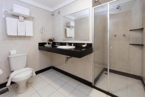 Ванная комната в Hotel Bahia do Sol