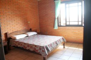 A bed or beds in a room at Pousada ACM Tramandaí - RS