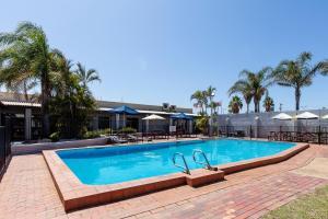 The swimming pool at or near Nightcap at Wintersun Hotel