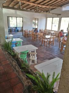 A restaurant or other place to eat at HOTEL MONTE VERDE