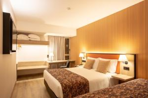 A bed or beds in a room at Hotel 3K Porto Aeroporto