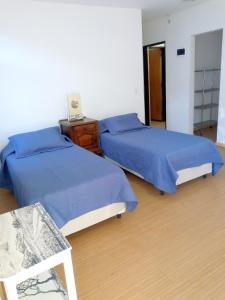 Una cama o camas en una habitación de B&B Garden Atelier